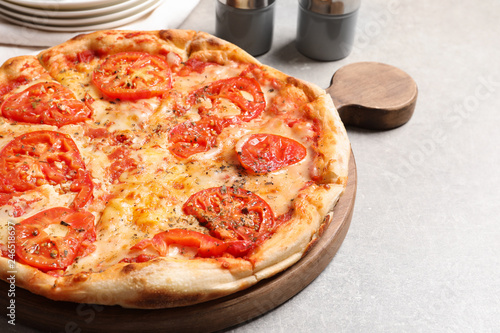 Hot cheese pizza Margherita on grey table