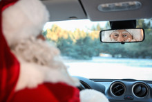 Authentic Santa Claus Looking Into Rear View Mirror Inside Of Car