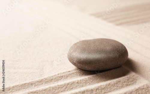 Acrylic Prints Stones in Sand Zen garden stone on sand with pattern, space for text. Meditation and harmony