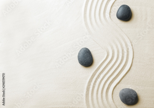 Photo sur Toile Zen pierres a sable Zen garden stones on sand with pattern, top view. Space for text