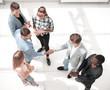 Team leaders meet multiracial interns in office explaining new job