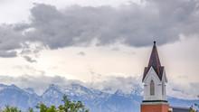 Church Steeple Against Mountai...