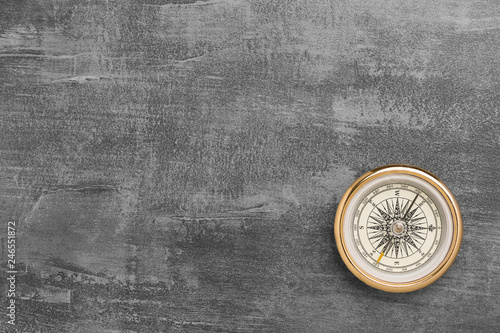Golden navigational compass on a vintage gray background Fototapeta