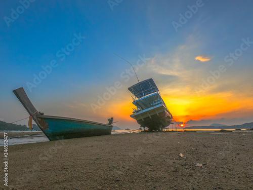 Foto  sweet sunrise above fishing boats on the beach