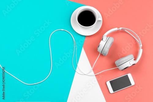 Fototapeta Headphones with cord on a bright color block background obraz na płótnie