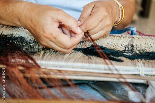 Woman hands weaving Thai silk fabric Fototapet