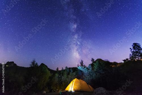 In de dag Kamperen A night landscape with a starry sky in the Swiss Alps.