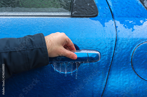Car door handle hand Interior Door Man Trying To Open Freezing Car Door Handle Hand On Cars Door Handle After Freezing Rain Glaze Ice Covering Car After Ice Storm Extreme Conditions Adobe Stock Man Trying To Open Freezing Car Door Handle Hand On Cars Door