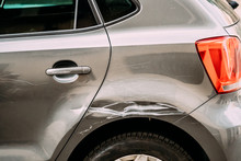 Broken Scratched Bumper Luxury Car Scratched With Deep Damage To Paint. Abandoned Car After Accident In Street