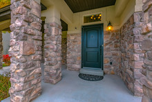 Home Entrance With Stone Wall And Porch In Utah