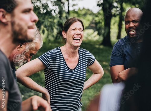 Fototapeta Cheerful woman in the park with her friends obraz