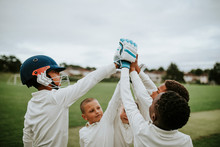 Group Of Young Cricketers Doin...