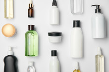 Top View Of Different Cosmetic Bottles And Container On White Background