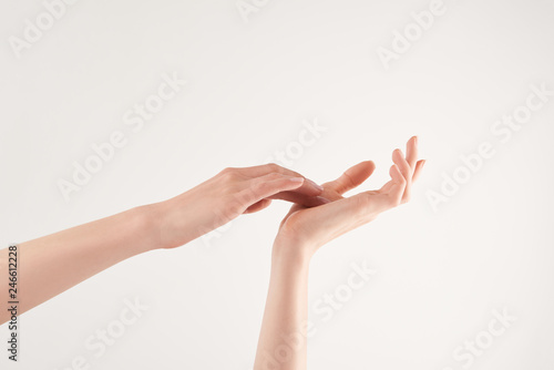 Fototapety, obrazy: Partial view of well-cared female hands on white background