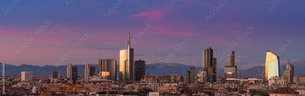Fototapety, obrazy: Aerial view of Milan skyline at sunset with alps mountains in the background.