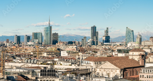 Spoed Fotobehang Milan Milan skyline. Large panoramic view of Milano city, Italy. The mountain range of the Lombardy Alps in the background. Italian landscape.