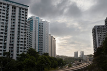 Public Housing HDB ResidentIal Apartments With LRT Track During Sunset In Singapore