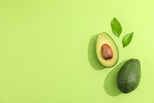 Ripe Sliced Avocado With Green Leaves, Top View