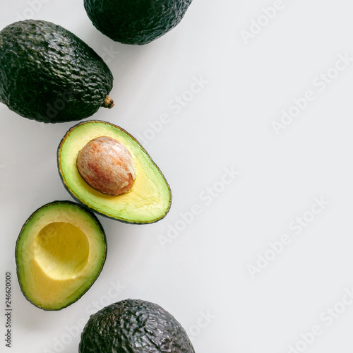 Fotografie, Obraz  Fresh organic hass avocados on a white background, top view with copy space