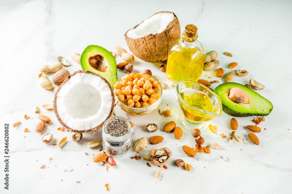 Fototapety, obrazy: Healthy vegan fat food sources, omega3, omega6 ingredients - almond, pecan, hazelnuts, walnuts, olive oil, chia seeds, avocado, coconut,  banner copy space