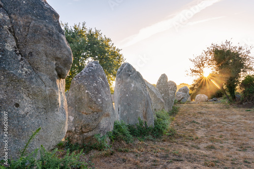 Fotobehang Historisch geb. French landscape - Bretagne. A field with several menhirs at sunrise.