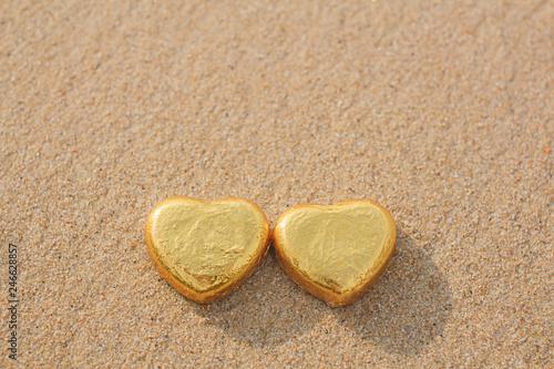 Fotografie, Obraz  Chocolate color Lovely golden heart on the beach