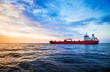 canvas print picture - Colorful sunset over the North sea and tanker cargo ship on a background, Netherlands