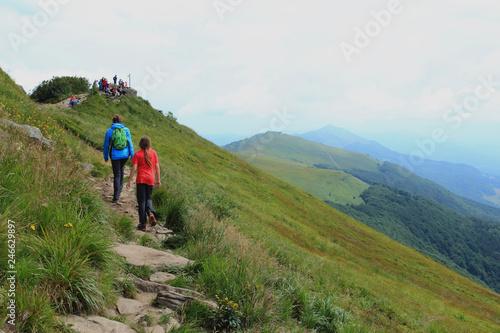 Polonina Welinska. Tourist on trekking path near mountain shelter Puchatek Hut (Chatka Puchatka), Bieszczady Mountains, Poland