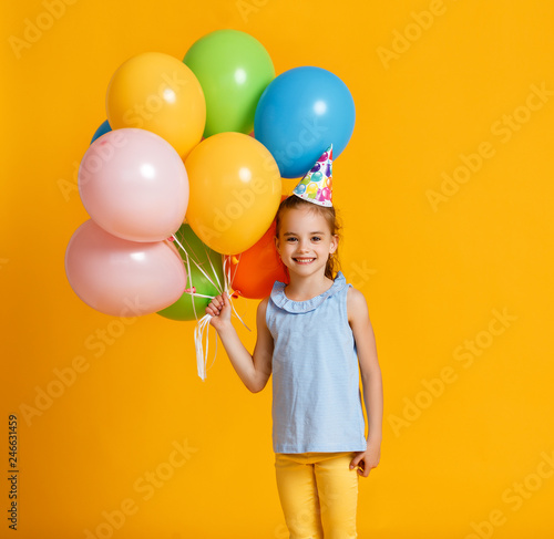 Happy Birthday Child Girl With Balloons On Yellow Background