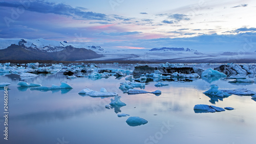 Wall Murals Arctic Jokulsarlon, glacier lagoon in Iceland at night with ice floating in water. Cold arctic nature landscape scenery. Ice melting.