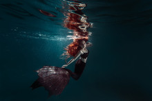 Red Hair Freediver Girl With Black Mermaid Tale