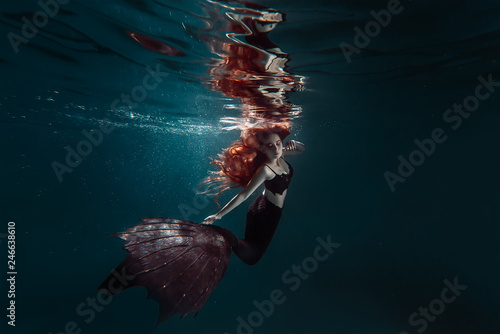 Canvas Print Red hair freediver girl with black mermaid tale