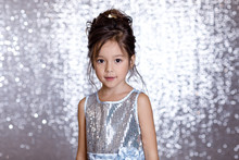 Cute Smiling Little Child Girl In Silver And Blue Dress