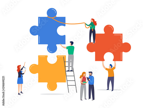 Tiny people connecting giant puzzle elements. Teamwork concept, cooperation, partnership metaphor. Wall mural