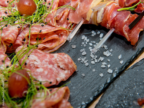 Meat and sausage cutting. Close-up.
