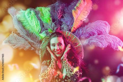Fototapeta Beautiful young woman in carnival peacock costume