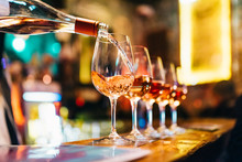 Service Serving Pouring Wine In Shiny Glasses In Bar Restaurant Night Club