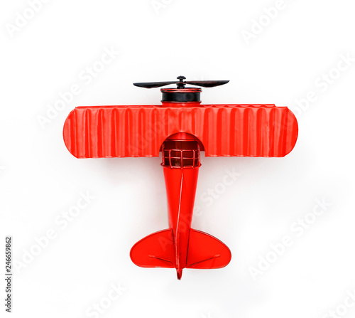 red Metal toy plane isolated on white