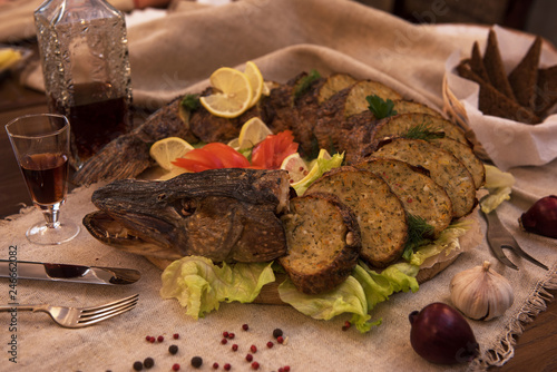 Gefilte fish: whole stuffed pike with vegetables and garnished fish