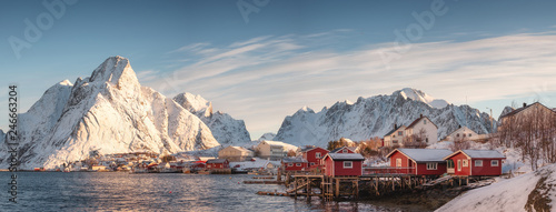 Wall Murals Northern Europe Scandinavian village with snow mountain at coastline in morning