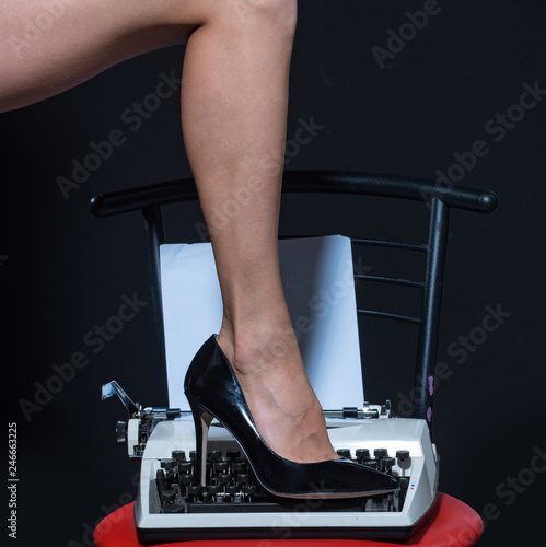 Tuinposter Akt Sexy legs. retro typewriter. modern fashion. fetish wear shoes on leg of woman. seducing you. love education. epilation and depilation. female skincare in spa. beauty. sexy secretary. delicious girl
