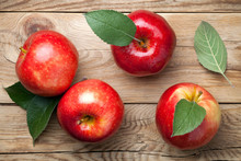 Red Apples With Green Leaves O...