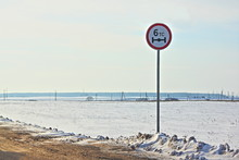 """Road Sign """"axle Load Limit 6 Tons"""" On The Side Of The Country Road In Winter In Russia"""