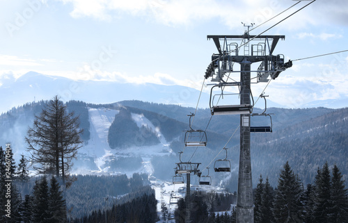Beautiful mountain landscape with chairlift. Winter vacation