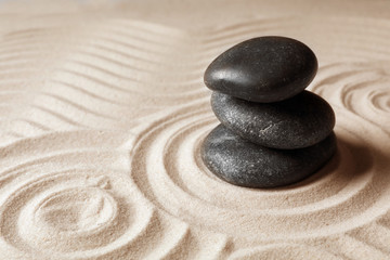 Fototapeta na wymiar Stacked zen garden stones on sand with pattern, space for text. Meditation and harmony
