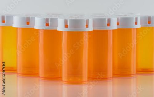 Photo  Prescription Pill Bottles on Reflective Surface