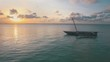 Aerial clip of a local dhow boat at sunset in Zanzibar