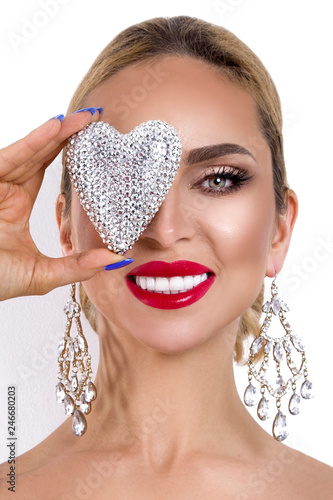 Valentine Beauty girl with silver heart jewelry and in elegant makeup isolated on white background Fototapete