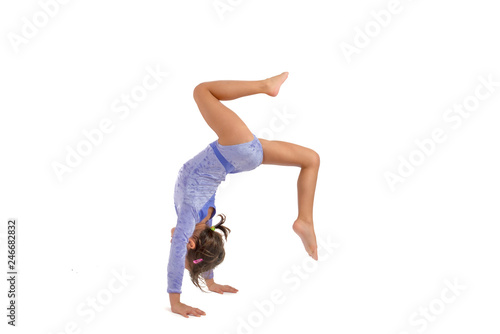 Spoed Foto op Canvas Gymnastiek Little gymnast on a white background. Sporting exercise, stretch, flexibility, aerobics