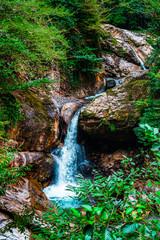 Panel Szklany Do salonu Mountain cascade waterfall. Eastern Abkhazia. Near the town of Tkvarcheli. Akarmara District.